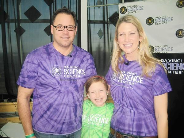 Sophie Babshak (center) with her parents Scott Babashak and Liz Keptner, official Da Vinci Science Center Spokesparents, at the center's 5th annual Ice Cream Wars on Jan. 5. The family presented awards to winning teams and Sophie conducted a live interview with the winning team.