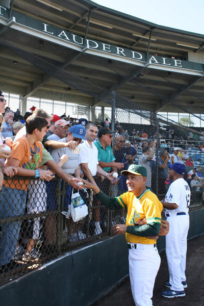 Former great shortstop Bert Campaneris signs autographs for fans at the Joe DiMaggio Legends Game at Fort Lauderdale Stadium. (Craig Davis, Sun Sentinel)