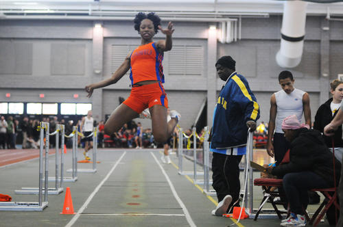 Natori Jones, 17, of Bloomfield High School lands in second place with a jump of 17 feet.