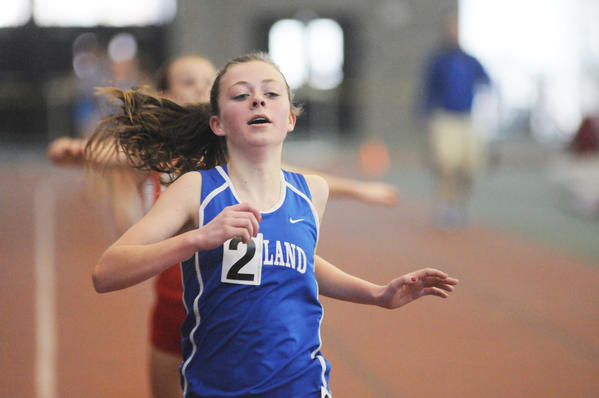 Caitlin Swanson, 14, of Tolland wins in the first heat of the 3200 meter run with 11:59.18