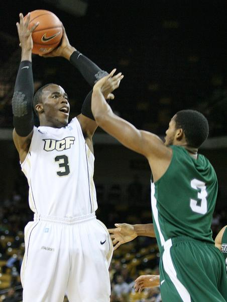 UCF guard Isaiah Sykes (3) looks to pass over Stetson forward Willie Green (3) during a college basketball game at the UCF Arena in Orlando, Florida on Thursday, December 20, 2012.