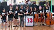 Children's orchestra members in Chinatown