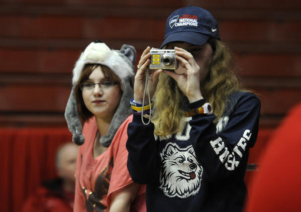Young UConn fans watch as the Huskies warm up before playing the Cincinnati Bearcats in a women's basketball game at Fifth Third Arena in Cincinnati Saturday.