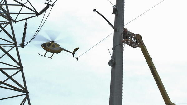 Connecticut Light & Power (CL&P)  used a helicopter to help string new high-voltage transmission lines in Manchester in April 2012.