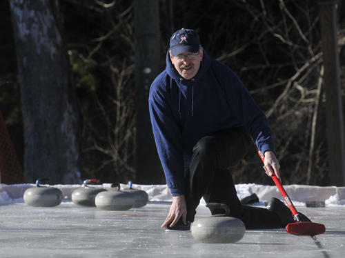 Terry Olson, of East Canaan, curls at the 2013 Alpine Ski Jumping Winter Carnival and Jumpfest at Satre Hill in Salisbury Saturday.  Olson is a member of the Norfolk Curling Club which is rasing money for construction of a new headquarters.  Their old building burned down in December of 2011.