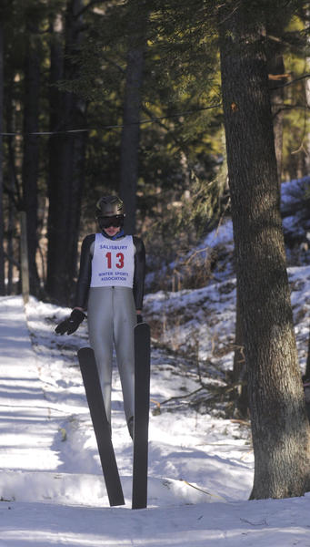 Charles Sheehan, 14, of Roxbury, competes in the junior ski jump competition at the 2013 Alpine Ski Jumping Winter Carnival and Jumpfest at Satre Hill in Salisbury Saturday.