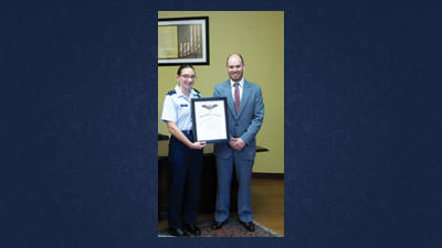 Mary Dice, receiving the Gen. Billy Mitchell Award from state Rep. Carl Walker Metzgar, R-Allegheny Township. The award is presented to Civil Air Patrol cadets who complete the second phase of the cadet program.