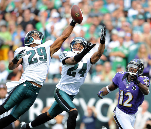 Philadelphia Eagles free safety Nate Allen (29) and Philadelphia Eagles cornerback Nnamdi Asomugha (24) break up a pass to Baltimore Ravens wide receiver Jacoby Jones (12) at Lincoln Financial Field in Philadelphia on Sunday.
