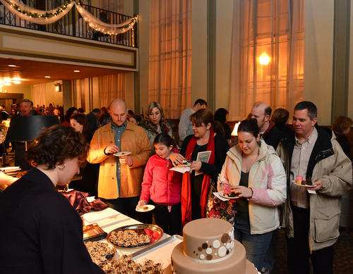 Crowds line up in front of Granny Schmidt's table during the 7th annual Chocolate Lovers' Soiree on Easton's Main Street. Event is a fundraiser for the Easton Main Street Initiative held at the Bank Street Annex on Saturday evening.