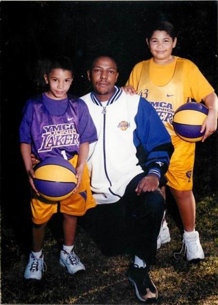 The late Victor McClinton -- shown with his sons, Kameron, left, and Kristian, right, about 10 years ago -- started the Brotherhood Crusade Youth Sports League, which has served Pasadena kids for 18 years.