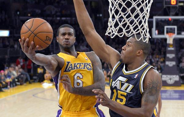 Earl Clark, shown putting up a shot against Utah's Derrick Favors, has averaged 10.6 points and 9.4 rebounds since moving into the Lakers' starting rotation earlier this month.