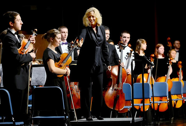 Maryland Symphony Orchestra Musical Director, Elizabeth Schulze, acknowledges the All-County High School Orchestra members Saturday night at North Hagerstown High School.