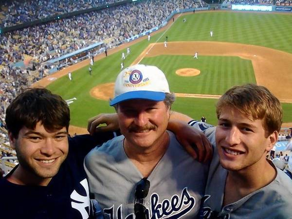 Dan Rosenberg, center, with his sons, Drew, left, and Evan, at a baseball game on Father's Day. Rosenberg is on a crusade against unlicensed drivers after Drew was killed by one.