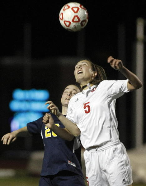 Lake Highland's Megan McMahon, right, and Trinity Preps Claire Callan battle for control of the ball on Saturday. (Reinhold Matay/Special to the Sentinel)