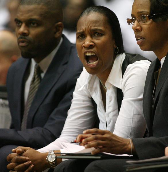 Cincinnati coach and former UConn player Jamelle Elliott coaches her players against Big East rival UConn at Fifth Third Arena in Cincinnati Saturday. UConn won, 67-31.