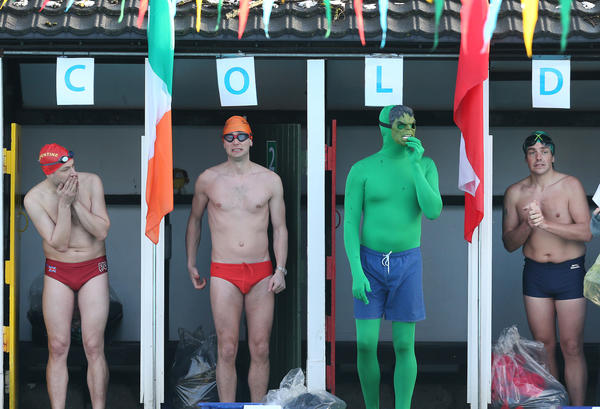 Competitors, one dressed as The Hulk, get ready to take part in the UK Cold Water Swimming Championships at Tooting Bec Lido on January 26, 2013 in London, England. Open to all comers the Championships involve swimmers of all ages and abilities.