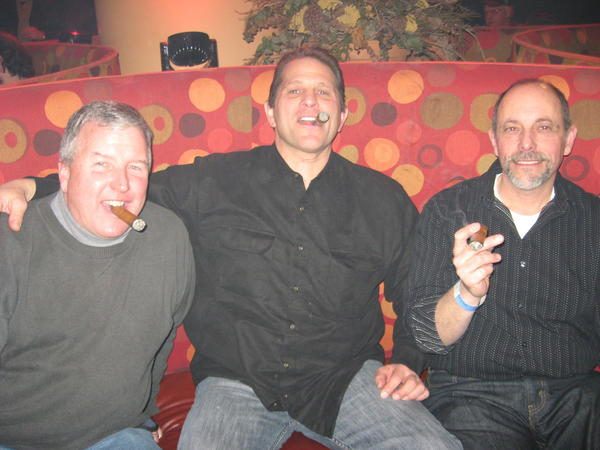 Enjoying Adonis cigars that were part of the opening night tasting event were, from left, Rich Smith and Dr. Tony Gallo of Kensington, and Angelo DiPietro of Berlin.