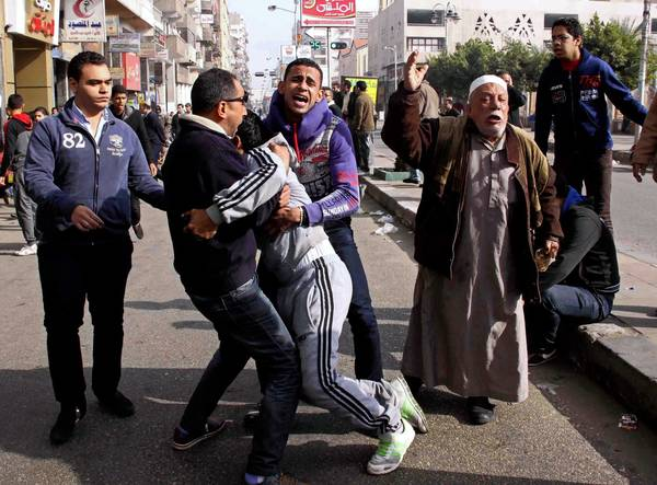 Relatives and supporters react to the death sentences given 21 soccer fans for a Port Said stadium riot in Feburary that left 74 dead.