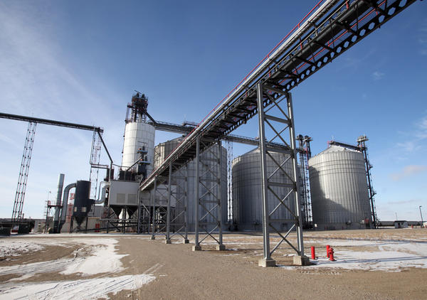 Large storage bins and the grinder are seen on the west side of the Glacial Lakes Energy LLC ethanol facility near Mina. Glacial Lakes and other area ethanol plants are operating at or above capacity, while others across the nation are shutting down.