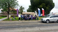 Brawley Relay for Life team paints Northend towns purple