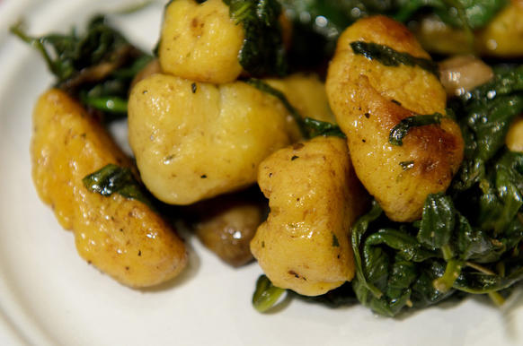Sweet potato gnocchi with pancetta, mushroom, and spinach from First And Last Tavern.