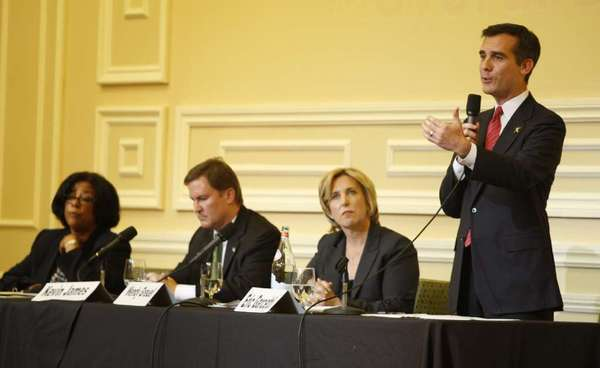 Los Angeles mayoral candidates Jan Perry, left, Kevin James, Wendy Greuel and Eric Garcetti debate in Hollywood Sept. 19.