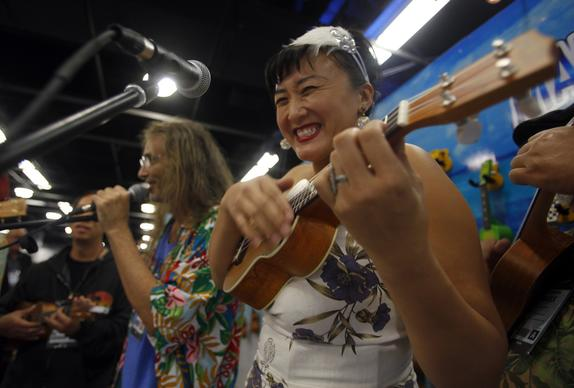 Claudia Choi plays a few licks at the Mahalo Ukulele booth at the NAMM Show in Anaheim.
