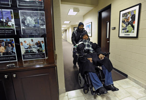 Former Ravens player and the senior adviser to Players Development O. J. Brigance leaves his office with assistant Paul Morris after a day of work at the Ravens' Under Armour Performance Center.