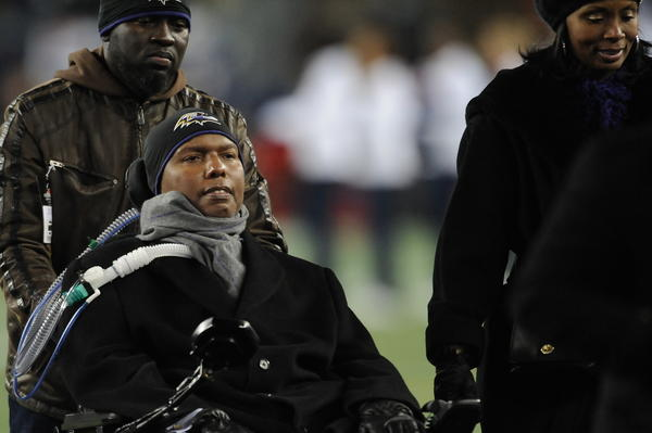 O.J. Brigance comes off of the field after the coin toss prior to the Baltimore Ravens vs. the New England Patriots in the AFC Championship game.