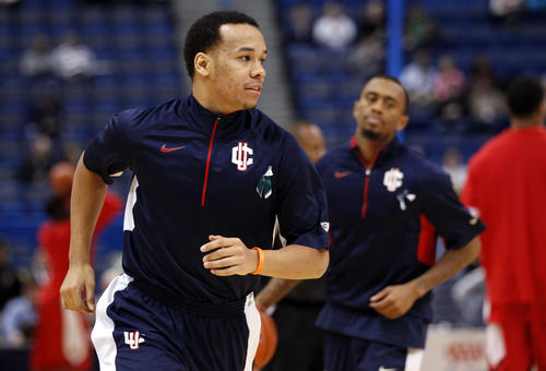 UConn guard Shabazz Napier, left, and Ryan Boatright warm up before the start of the game against the Rutgers Scarlet Knights at the XL Center.