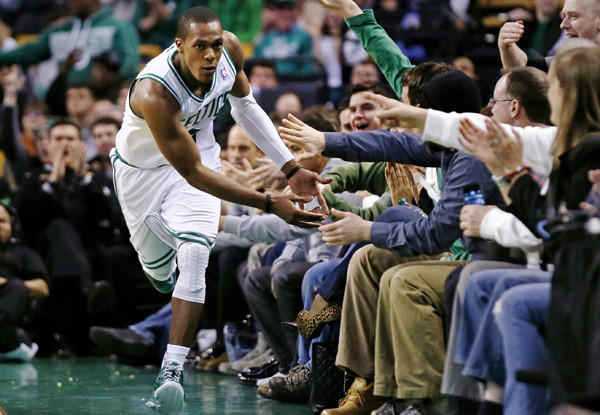 Celtics point guard Rajon Rondo receives congratulations from fans courtside in Boston after scoring against the Charlotte Bobcats during a game earlier this month.