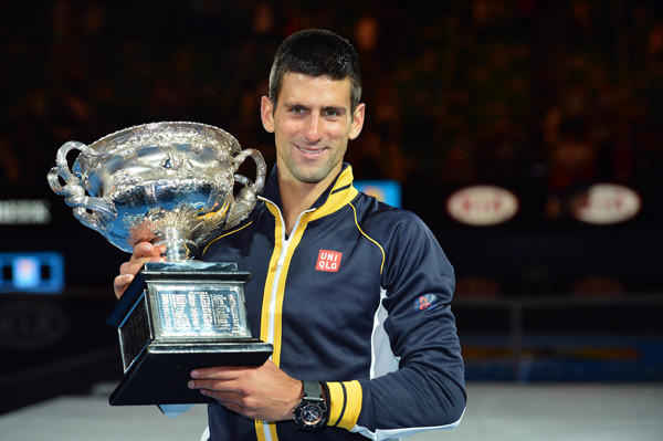 Novak Djokovic poses with the championship trophy after defeating Andy Murray in the men's final of the 2013 Australian Open.