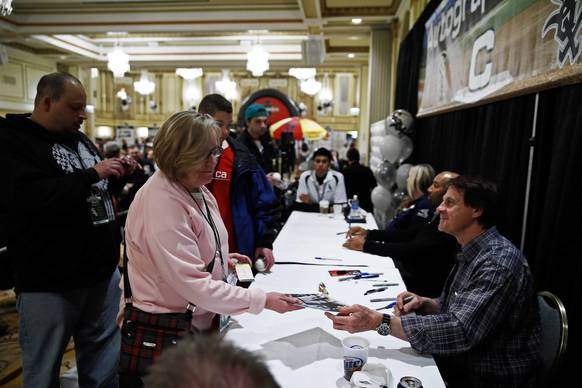 Former White Sox manager Tony LaRussa joins Harold Baines as they sign autographs on Sunday at SoxFest.