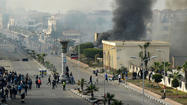 PORT SAID, Egypt -- President Mohamed Morsi invoked emergency powers in three cities Sunday night to stem riots that have killed nearly 50 people and raised questions over whether his Islamic-backed government can secure order amid sharpening political turmoil.