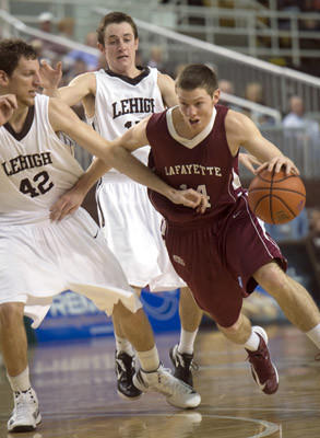 Lafayette's Bryce Scott drives in against Lehigh's Gabe Knutson in their Mens Basketball game at Stabler Arena in Bethlehem on Sunday.