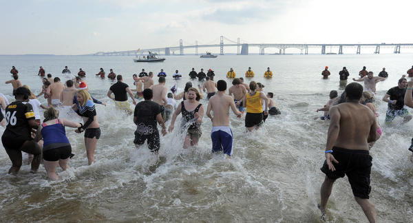 Maryland State Police host the 17th annual Polar Bear Plunge at Sandy Point State Park to benefit Special Olympics Maryland.