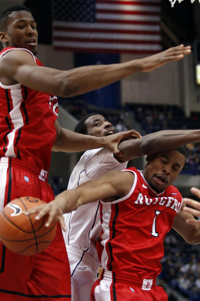 Rutgers guard Jerome Seagears, right, and forward Kadeem Jack, left, work for the loose ball against UConn forward DeAndre Daniels during the second half at the XL Center.