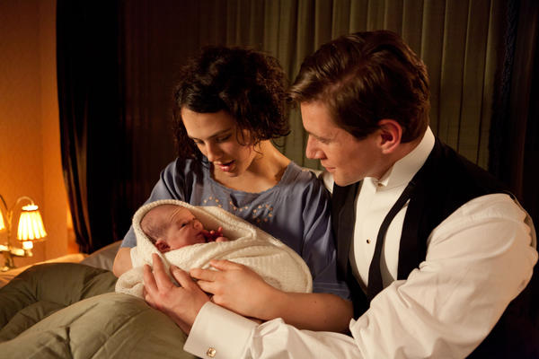 "Jessica Brown-Findlay as Lady Sybil and Allen Leech as Tom Branson in ""Downton Abbey."""