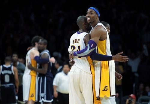 Lakers guard Kobe Bryant and center Dwight Howard embrace after defeating the Thunder, 105,96, on Sunday afternoon at Staples Center.