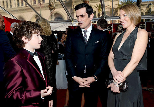 """Modern Family"" actors Nolan Gould, left,  and Ty Burrell, and Holly Burrell."