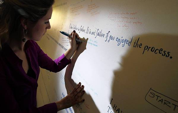 Natalia Williams, a marketing coordinator with Dun & Bradstreet Credibility Corp. in Malibu, writes on the company's Failure Wall. Chief Executive Jeff Stibel believes that you have to be willing to fail in order to learn -- so he has all of his employees write on the wall about the times they have messed up in their lives.