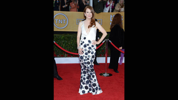 Julianne Moore can do no wrong when it comes to the red carpet. She's in a white Chanel couture gown with black and white floral embroidery on the skirt.