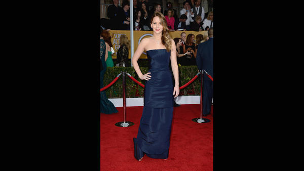 Number 2 of the fashion troika, Jennifer Lawrence, is walking the SAG Awards red carpet, apparently with walking pneumonia. Her navy blue gown is by Dior.