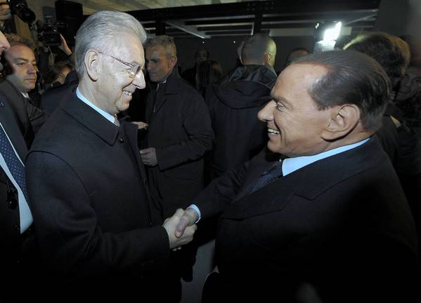 Italian Prime Minister Mario Monti, left, and former Prime Minister Silvio Berlusconi attend an event in Milan. Berlusconi has come under fire for his defense of former dictator Benito Mussolini.