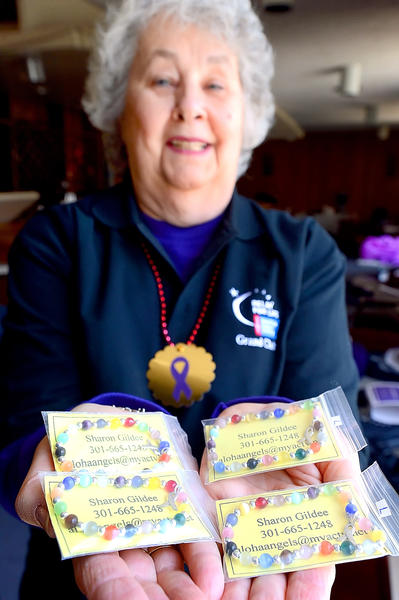 Sharon Gildee of Hagerstown shows off her cancer awareness bracelets Sunday afternoon during the Relay for Life kickoff in Hagerstown.
