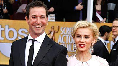 Noah Wyle and Sara Wells on the red carpet.