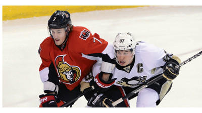 Ottawa Senators Kyle Turris, left, pushes back as Pittsburgh Penguins Sidney Crosby defends in front of the net during first period of NHL action at the Scotia Bank Place in Ottawa on Sunday.