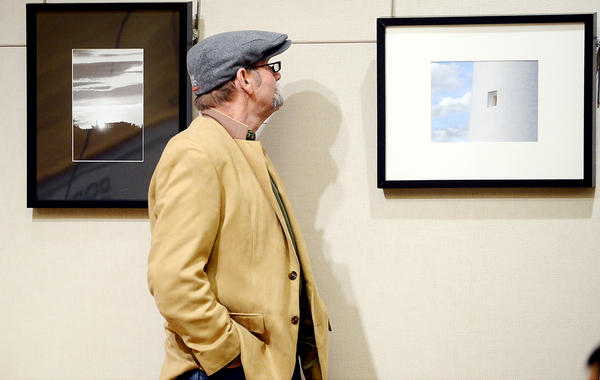 Norman Naylor of Hampstead, Md., took a close look at several entries on display at the Cumberland Valley Photographic Salon Sunday afternoon at the Washington County Museum of Fine Arts.