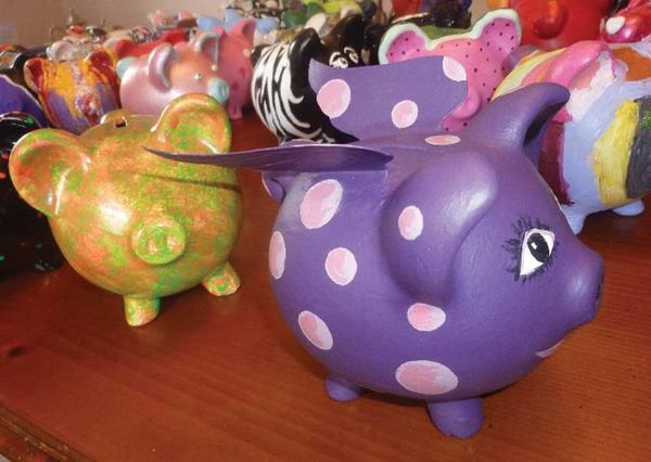 The United Way of Franklin County and Council of the Arts are wrapping up an eBay sale of painted piggy banks to benefit the United Way's annual campaign. The pigs will continued to be on display this week.