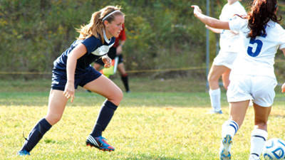 Mount Aloysius College junior Tonya Bibby of Windber, left, is shown on the soccer field. Bibby was named to the Womens College Division Scholar All-East Region Team by the National Soccer Coaches Association of America.